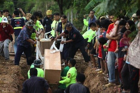 Officials work through the weekend to recover the remains of 26 people at a trafficking camp in Songkhla