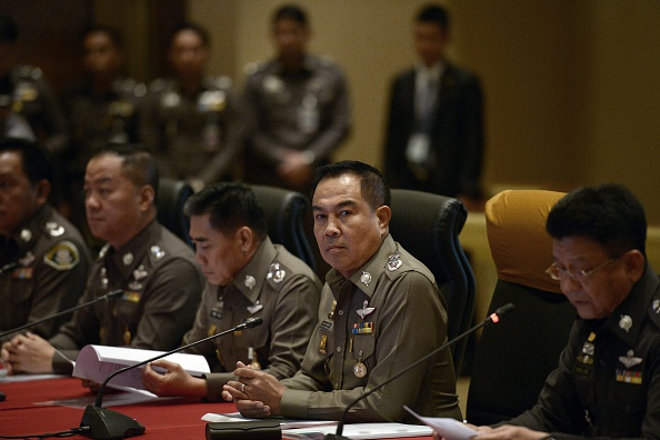 Thai national police chief Somyot Poompanmoung (C) attends a press conference at the Royal Thai Police headquarters in Bangkok on November 25, 2014.  Thai police said on November 25 they had charged seven policemen and five civilians in a widening corruption probe that has seen 61 million USD of assets confiscated after the rare arrest of three high-ranking officers for royal defamation. Former Central Investigation Bureau chief Pongpat Chayapun, his ex-deputy Kowit Vongrongrot and Major General Boonsueb Praithuen, the former head of the marine police, have all been charged under Thailand's strict lese majeste rules.  AFP PHOTO/Christophe ARCHAMBAULT        (Photo credit should read CHRISTOPHE ARCHAMBAULT/AFP/Getty Images)