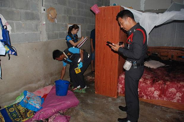 Police and forensic officers inspect the house of a village head in Sikao district of Trang after he was killed with acid on May 2. (Photo by Methee Muangkaew) Please credit and share this article with others using this link:http://www.bangkokpost.com/news/general/549527/painful-end-for-philanderer. View our policies at http://goo.gl/9HgTd and http://goo.gl/ou6Ip. © Post Publishing PCL. All rights reserved.
