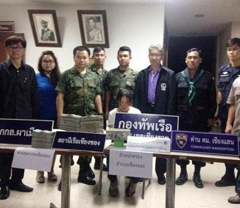 The woman, identified as Mon Intapan, was taken to the Chiang Khong immigration