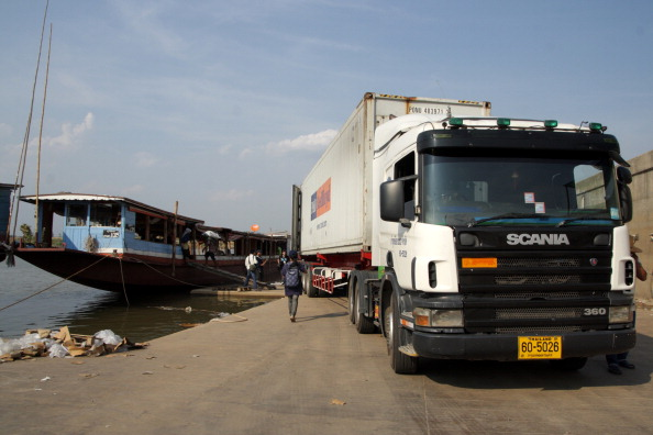 CHIANG SAEN COMMERCIAL PORT, CHIANG RAI, THAILAND - 2013/04/23: Cargo trucks parking in Chiang Saen Commercial Port. An important gateway in northern Thailand to the Greater Mekong Subregion. Located on the mouth of the Sop Kok River in Chiang Saen district of Chiang Rai.The commercial port is the second port in Chiang Saen, which has found itself at the forefront of the export and import trade with Yunnan Province in China , Myanmar, and Lao PDR . The port is ready to accommodate more trade and logistics activities when ASEAN Economic Community (AEC ) is in place in 2015.. (Photo by Piti A Sahakorn/LightRocket via Getty Images)