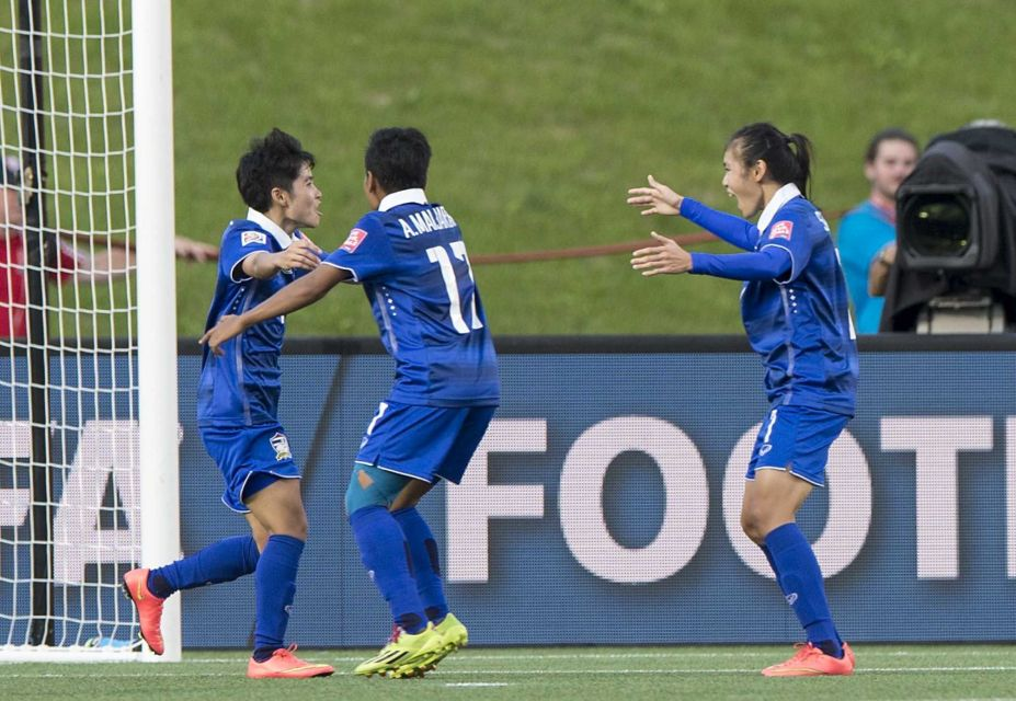 Thailand's Orathai Srimanee (L) celebrates after scoring against Ivory Coast during a Group B match at the 2015 FIFA Women's World Cup at Lansdowne Stadium in Ottawa