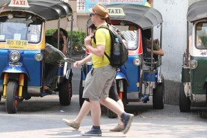 """tuk-tuk drivers telling foreign tourists that famous attractions, such the Grand Palace, are """"closed,"""" and then offering the tourists discounted rides around the city"""