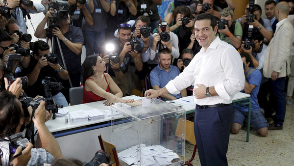 Prime minister Alexis Tsipras votes at a polling station in Athens, calling on Greeks to take their 'destiny into their own hands'