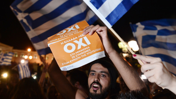 People celebrate in Athens after exit polls indicate a No vote