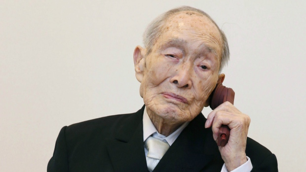 Sakari Momoi, a Japanese retired educator, poses for a photo after receiving a certificate from Guinness World Records as Momoi was recognized as the world's oldest living man, in Tokyo