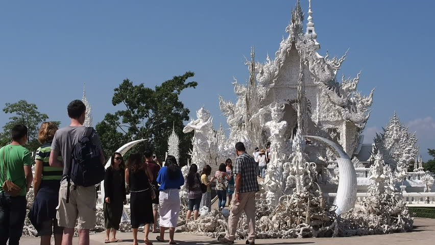Chinese tourists take pictures at Wat Rong Khun