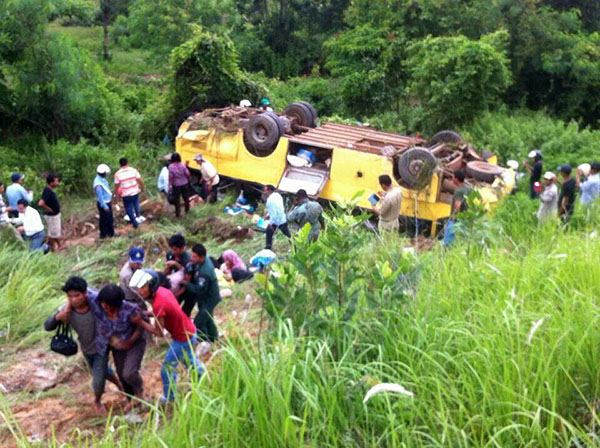 A tour bus returning to Cambodia from Thailand slid down a ravine and flipped, killing 16 passengers returning from a shopping trip