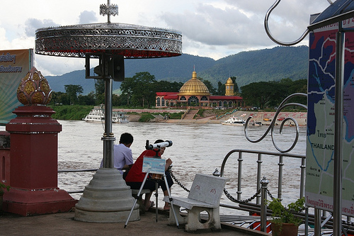 Tourists look across at King Romans Casino from Chang Saen Chiang Rai