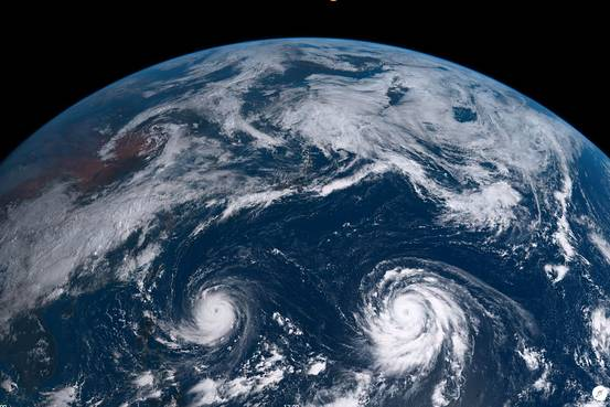 Typhoon Goni, left, and typhoon Atsani, right, is seen over the Pacific Ocean at 9:40 a.m. Japan time in this image taken by Japan Meteorological Agency's Himawari 8 satellite.     Japan Meteorological Agency