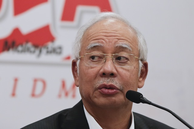 Malaysia's Prime Minister Najib Razak  speaks to members of the media during a news conference at Kuala Lumpur