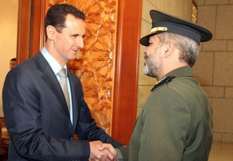 Qassem Soleimani, head of Iran's Islamic Revolutionary Guard Corps' Qods Force, responsible for terror operations abroad, with Syrian President Bashar