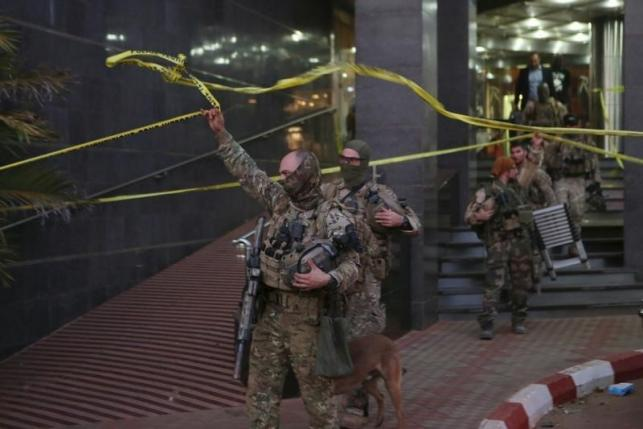 French soldiers leave the Radisson hotel in Bamako, Mali.