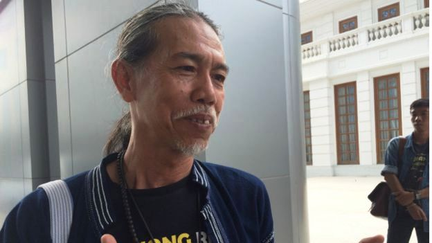Niwat Roykaew, a village leader in Chiang Khong district of Chiang Rai leaves court