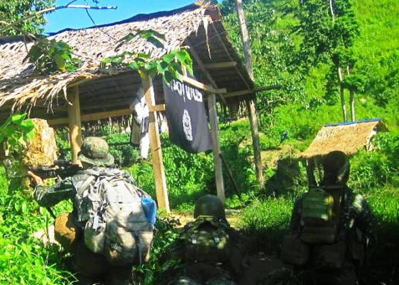 Philippine marines raid the site of a criminal gang that pledged allegiance to Islamic State jihadists, in Palimbang town on Mindanao