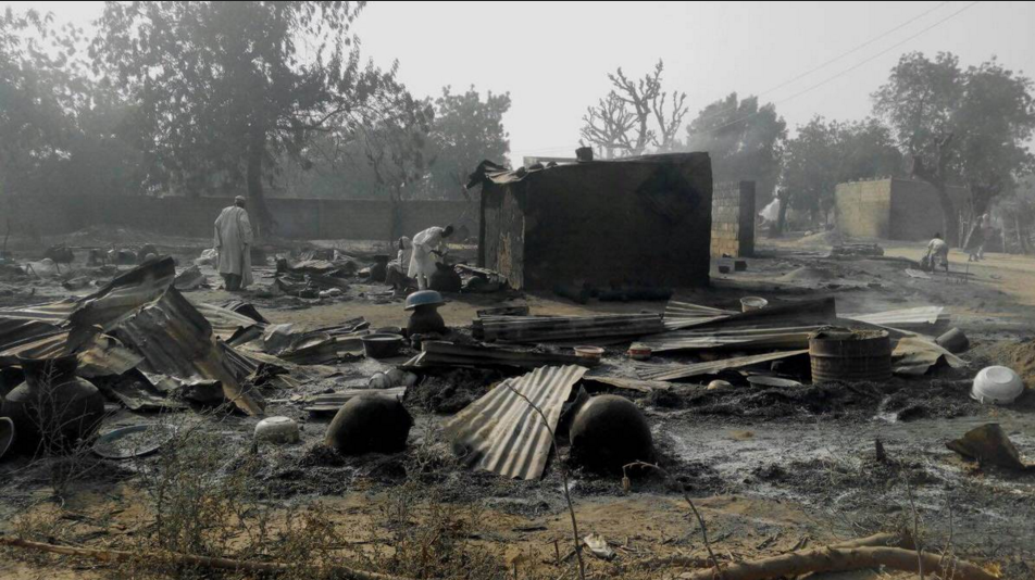 Charred corpses and bodies are scattered on the streets of Dalori,