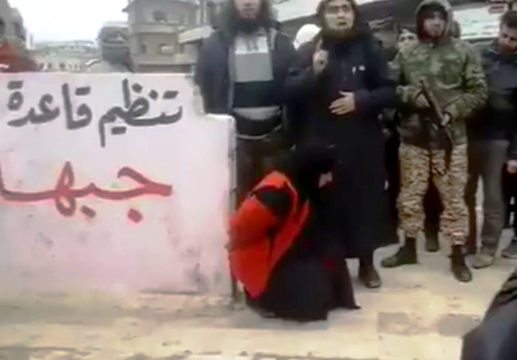 the 20-year-old man executed his mother on Wednesday near the post office building where she worked in front of hundreds of people in Raqqa