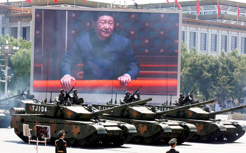 Chinese President Xi Jinping is displayed on a screen as Type 99A2 Chinese battle tanks take part in the parade in Tiananmen Square Photo: AP Photo