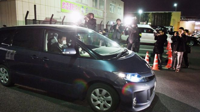 A car containing the kidnapped girl leaves a police station in Saitama Prefecture