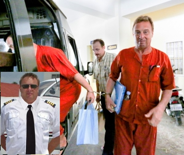 American Brian Naswall (R), the 53-year-old CEO of Aero Cambodia, exits a prison van at Phnom Penh municipal court