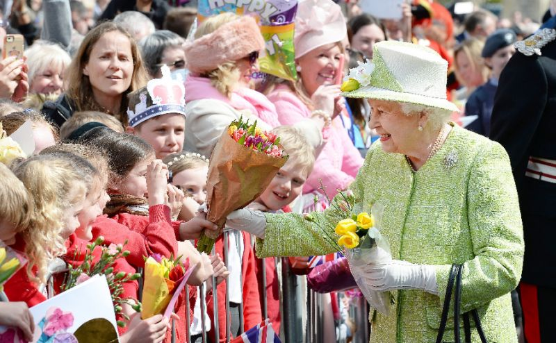 Britain's Queen Elizabeth II greets wellwishers on her 90th birthday during a walkabout in Windsor