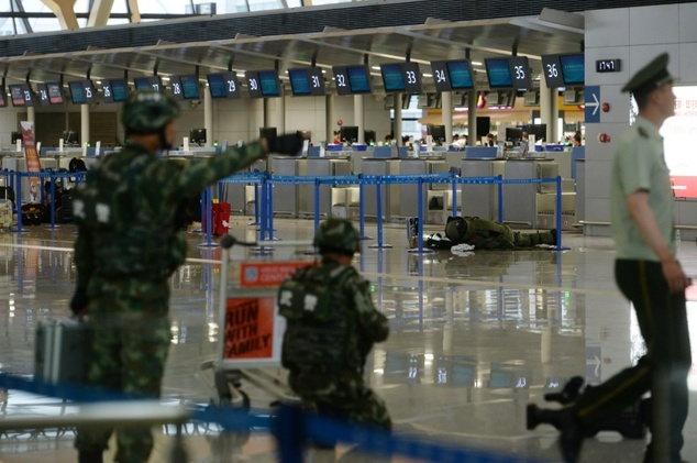 Paramilitary officers standing guard at Pudong International Airport in Shanghai after a blast that officials said was set off by a man carrying a homemade explosive
