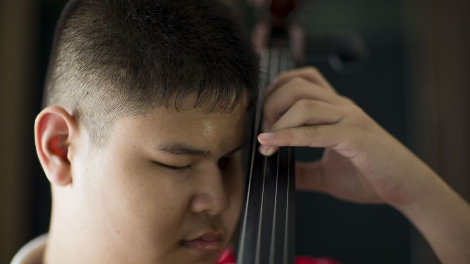Kritsada Thanyawanichapong, 16, a member of the Thai Blind Orchestra, practices cello prior to a rehearsal at a school for the blind in Lopburi province, Thailand, on May 12, 2016.