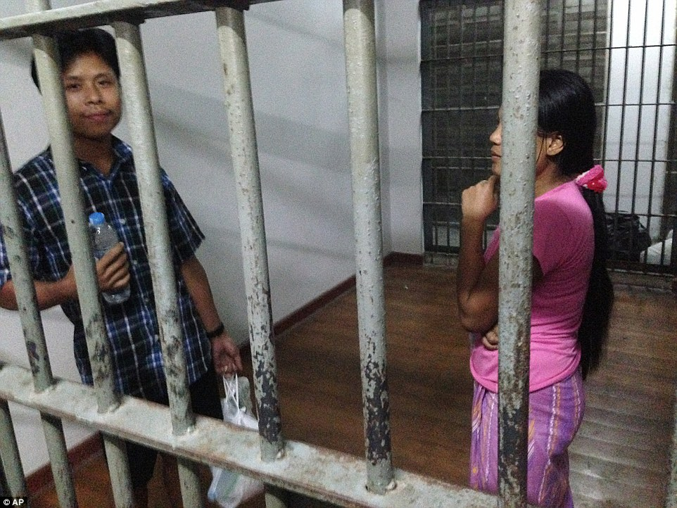 Shrimp shed worker Tin Nyo Win and his wife Mi San, stand in a jail cell after they were arrested in Samut Sakhon in November last year. (AP Photo)