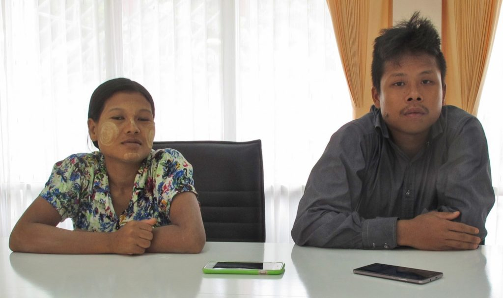 Burmese former shrimp shed worker Tin Nyo Win, right, sits with his wife, Mi San, during an interview in Patum Thani, Thailand.