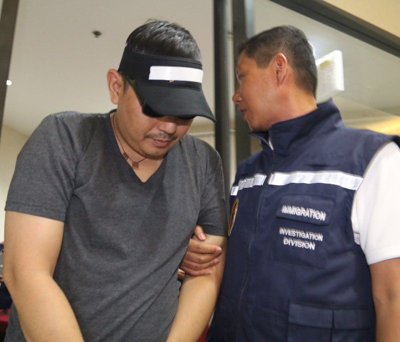 Filipino Patrick Philip Gutierez Alemania is escorted by police being arrested Wednesday
