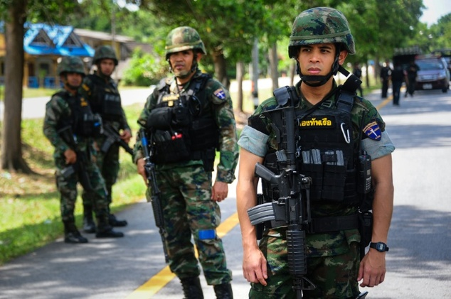 Thai soldiers stand by the scene of an attack by suspected separatist militants in southern Thailand