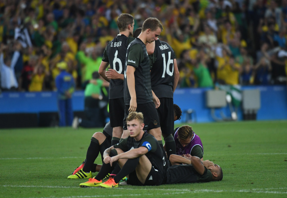Germany players react after losing to Brazil in the men's gold medal match during the Rio 2016 Summer Olympic Games at Maracana. Mandatory Credit: Christopher Hanewinckel-USA TODAY Sports ORG XMIT: USATSI-322476 ORIG FILE ID:  20160820_sal_ah2_308.JPG