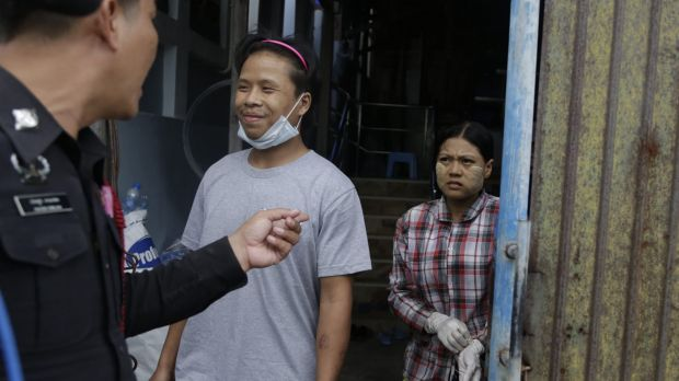 Tin Nyo Win, centre, smiles as he is reunited with his wife, Mi San, in Samut Sakhon, Thailand in November. Photo: AP