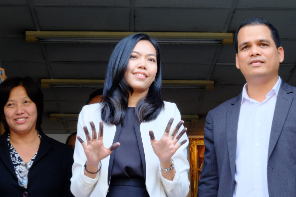 """Sirikan """"June"""" Charoensiri, a human rights lawyer with the organisation Thai Lawyers for Human Rights after being finger printed by Police."""