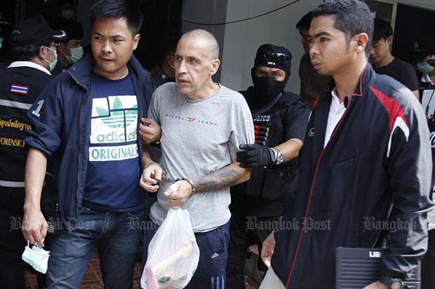 Officers escort Shimon Biton, 50, to the Bang Bua Thong police station in Nonthaburi on Saturday to face murder charges. (Photo by Thanarak Khunton)