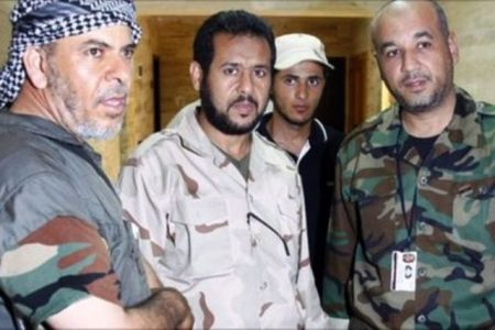 Abdel Hakim Belhadj (Center) and his pregnant wife were abducted by US CIA agents in Thailand in 2004